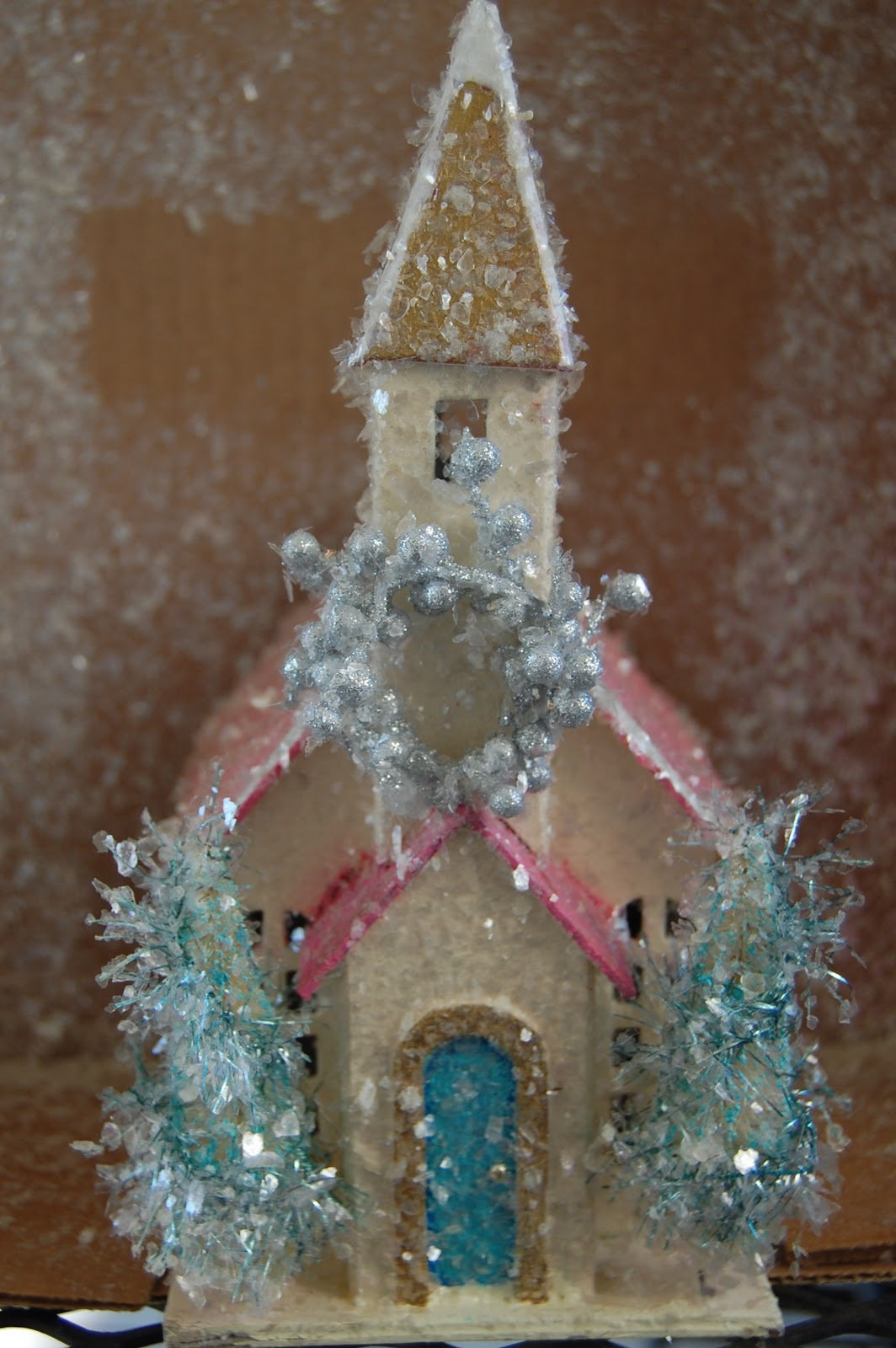 Natalie loves do it yourself glittered christmas houses it had a red roof so she painted it pink with gold accents and a turquoise door she made a big wreath out of an old pick solutioingenieria Gallery