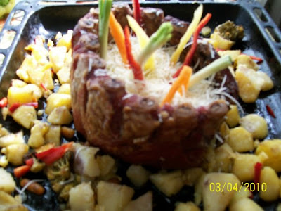 Articole culinare : Coronita de purcel cu legume la cuptor