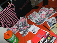 Merchandise table at Kuchen mit Rock; photo by Val Phoenix