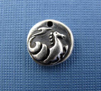 silver seahorse ancient monster charm jewelry
