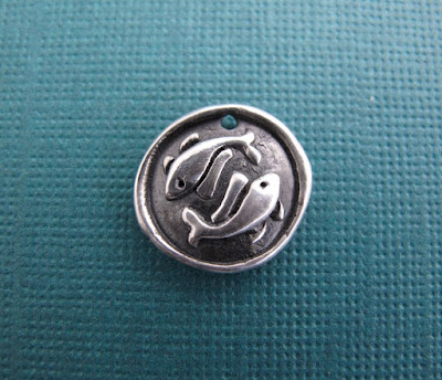 silver buddhist two golden fishes charm