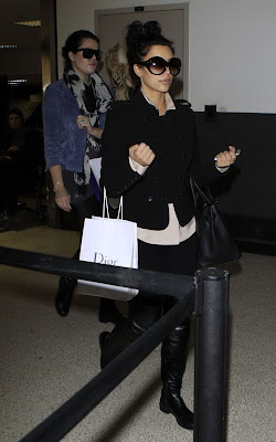 Kim and Khloe Kardashian Arriving on a flight at LAX Airport Pics
