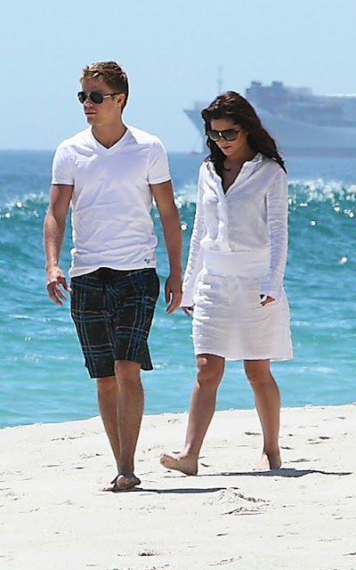 Cheryl Cole and Derek Hough taking a stroll along the beach in South Africa