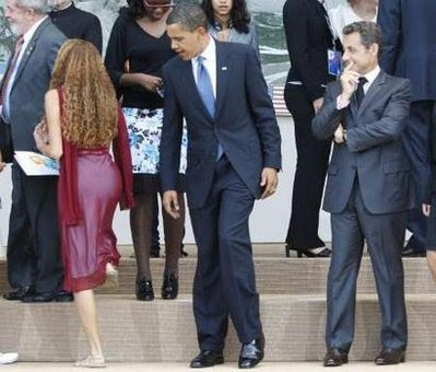 obama looking at girl