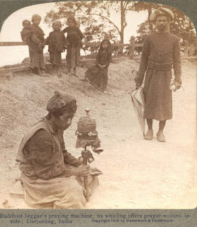 India 100 years ago: Buddhist beggar's praying machine; its whirling offers prayer written inside - Darjeeling, India