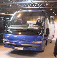 Attractive 34-seat open top midi coach by Indcar with 34 rugged though comfortable seats