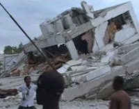 People are seen near the ruins of a building, which was destroyed after a major earthquake struck, in Port-au-Prince in this January 12, 2010 video grab. The magnitude 7.0 quake hit impoverished Haiti on Tuesday, toppling buildings in the capital Port-au-Prince, burying residents in rubble and causing many deaths and injuries, witnesses in the city said.REUTERS/Reuters TV (HAITI - Tags: DISASTER ENVIRONMENT)