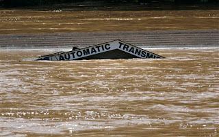 The roof of an auto shop is barely visible above swollen Sweetwater Creek after heavy rains of recent days caused the creek to flood, Tuesday, Sept. 22, 2009, in Austell, Ga. (AP Photo/John Amis)