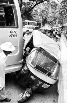 Autorickshaw crushed in between two buses