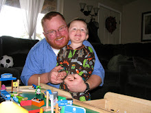 Daddy and Jack playing with the train table
