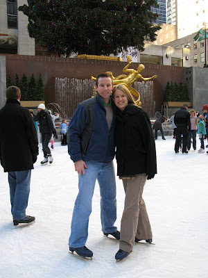 Ashley and Ken on the ice skating rink in Rockefeller Center on Christmas Eve Day in New York