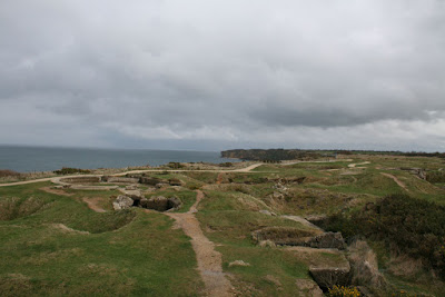 The landscape at Pointe du Hoc showing the depressions from bombs and former entrenchments