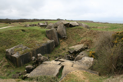 A former armory that was exploded by a bomb scattering concrete in Ponte du Hoc
