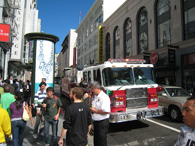 Apple Employee from the Apple Store checks with the Fire Captain or Marshall about the issue