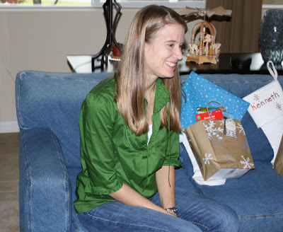 Ashley watches as others start opening gifts.