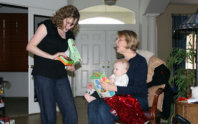 Kimberly and mom open up and show Lincoln some of his gifts.