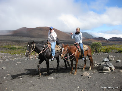 Sunrise and Tours at Haleakala Volcano Crater: Posing on our horses before heading back up to the top.