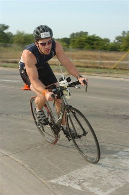 Aaron Fanetti biking in the 2009 Ironman 70.3 Steelhead
