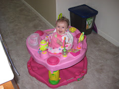 Hannah in her exersaucer
