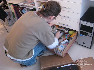 meda searching through her painting drawer