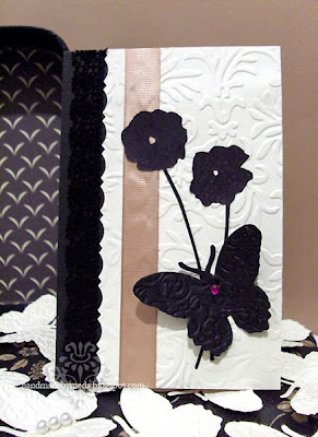 black butterfly and poppies