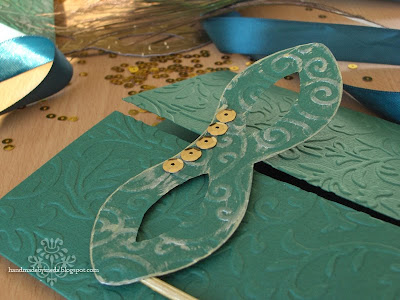 emerald invitation with  a mask with gold sequins