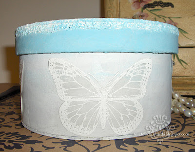 white butterfly blue box