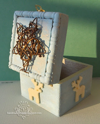 blue box with a star and reindeers