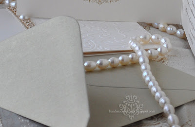 gold invitation with pearls -detail