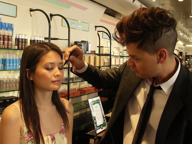 Le Métier de Beauté make-up artist Ivan Castro applies eyeshadow