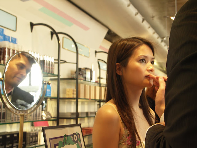 Le Métier de Beauté make-up artist Ivan Castro applies lipgloss
