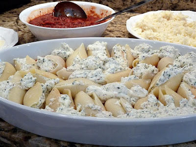 preparing stuffed shells or manicotti