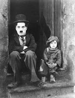 "Scene from Charlie Chaplin's Film ""The Kid"" showing poverty"