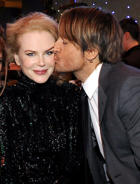 Keith Urban kisses wife Nicole Kidman at a Capitol Records ACM bash in Las