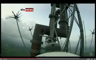 workers scaling a broadcasting antenna video