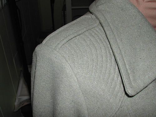 sewed in the sleeves and closed the sideseams. Here's a peek.