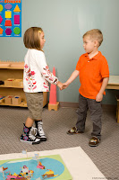 NAMC montessori circle time routines first day welcome songs students shake hands