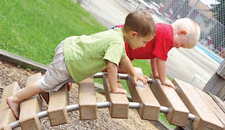 NAMC montessori grace and courtesy important social lessons boys playing