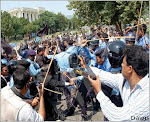 ISLAMABAD - Sept 4: Photographers grab the scene of clash between protesting lawyers and police out