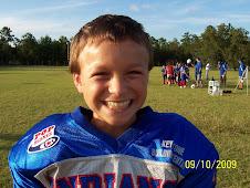 Brandon #8, Best Football Player on Jr. PeeWee team.