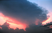 Thunderstorm anvil at sunset - U.S. National Oceanic and Atmospheric Administration - public domain