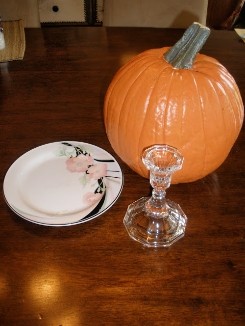 plate, fake pumpkin, glue, candlestick holder
