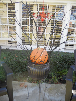 halloween decor using pumpkins and sticks