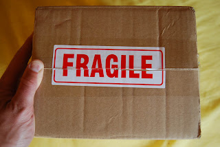 A box marked FRAGILE