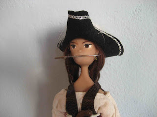 pirate doll, dagger in mouth