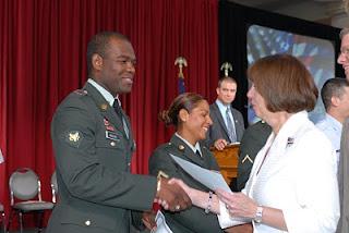 Receiving congratulations and a Certificate of Naturalization