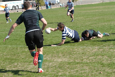 BYU Rugby Scrumhalf Ken McKenzie finishes the drive with a reach for the try line