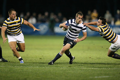 Fullback Sam Thorley shakes a Cal forward to gain some ground
