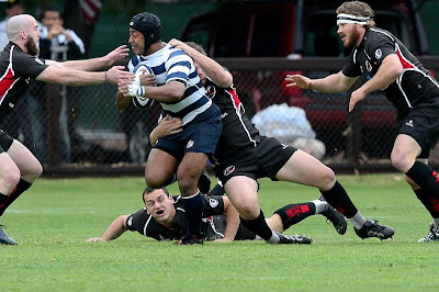 BYU Rugby Flanker Apenisa Malani breaks the SDSU defense in the 2009 Semis