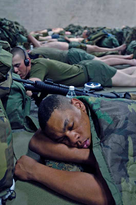 Soldiers sleeping on the floor